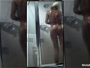 Home video of Nikita Von James taking a douche