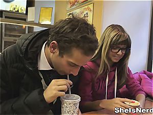 petite nerdy female takes juice on her specs